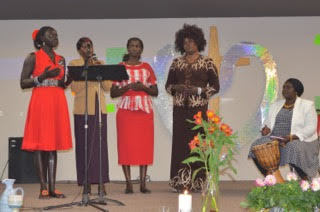 South Sudanese women sharing a song on Sunday morning