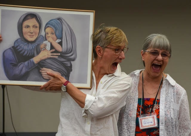 Valerie Proudfoot gifted speaker, Irma Fast-Dueck, with a picture of Mennonite Mary